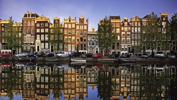 Reflections in a canal amsterdam wallpaper
