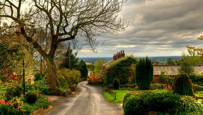 Lovely road through quaint english village wallpaper