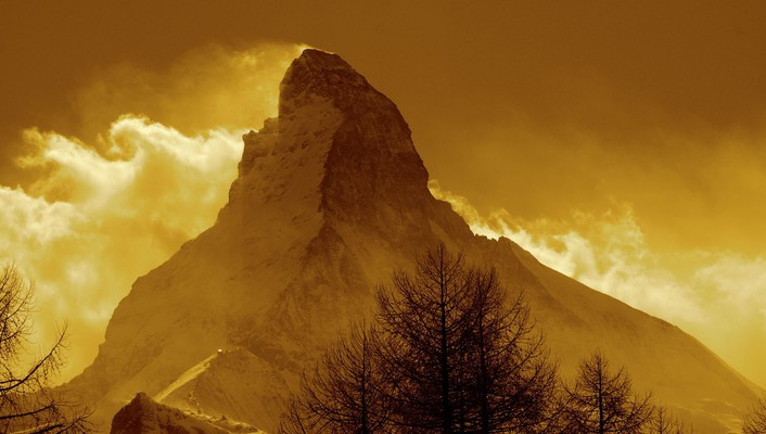 The matterhorn in gold wallpaper