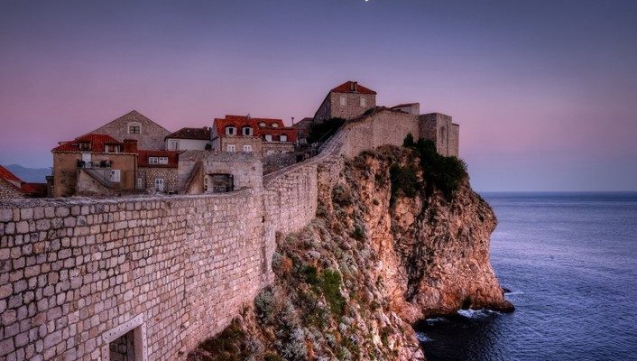 Walled town on a sea coast cliff wallpaper