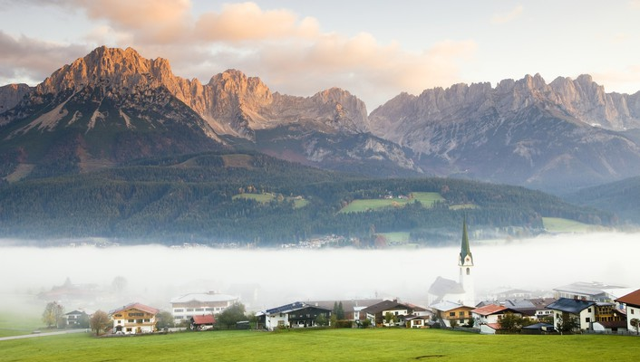 Austrian tyrol village in fog wallpaper