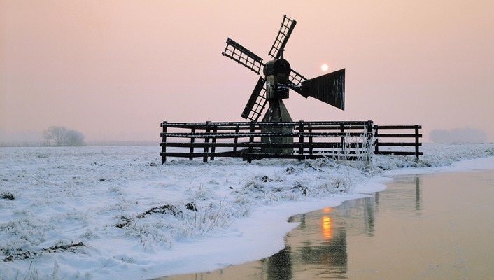 Windmill by the river at winter wallpaper