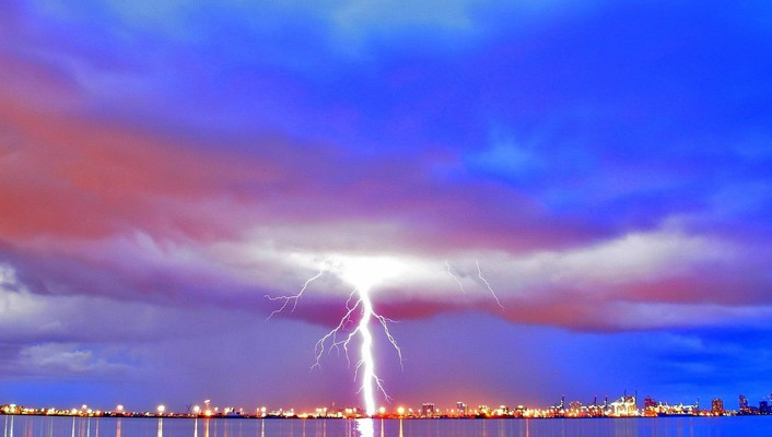 Mighty lightning over seaside city wallpaper
