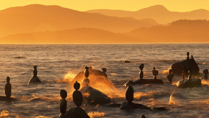 Rock statues on a vancouver shore wallpaper