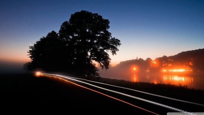 River road in fog and long exposure wallpaper