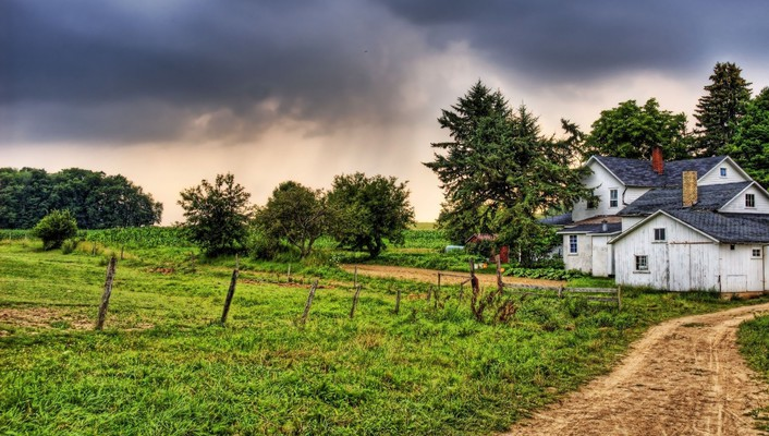 Country home under stormy sky wallpaper