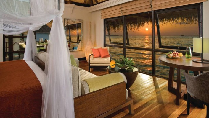 Evening dusk view out of water bungalow wallpaper