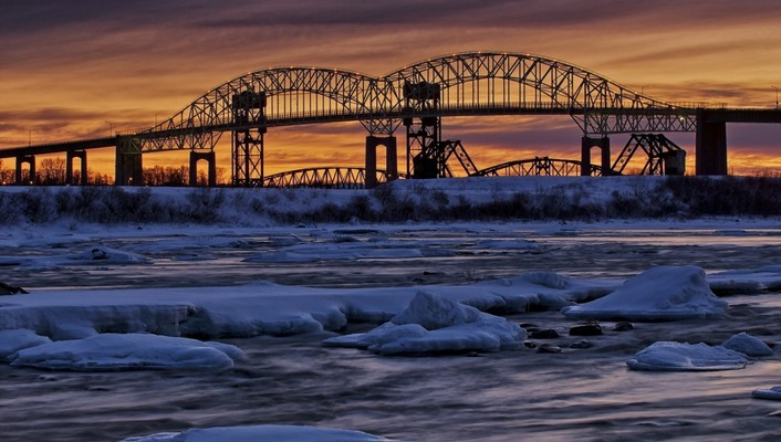 Dual bridges over a river in winter wallpaper