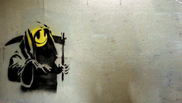 Grim reapers smiley face spray paint wallpaper