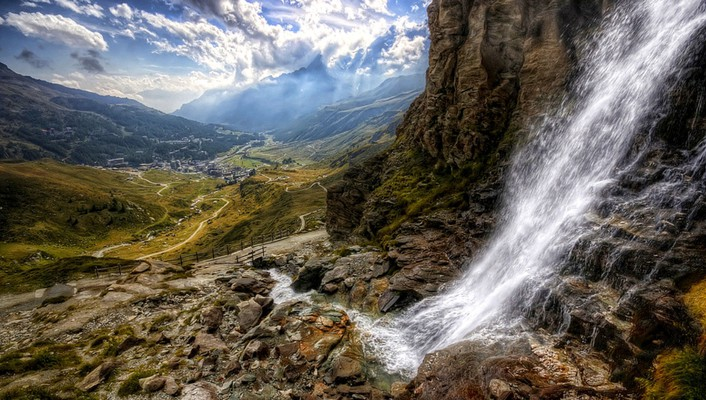 Waterfall to a stream down the valley hdr wallpaper