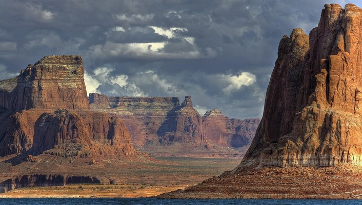 Storm clouds over canyon river wallpaper