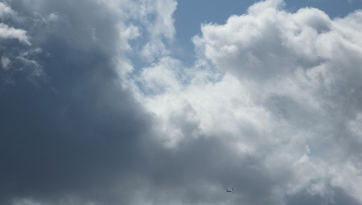 Airplane going through the clouds wallpaper