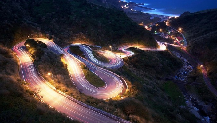 Road in lights down to the beach wallpaper