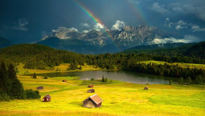 Rainbow over mountain village wallpaper