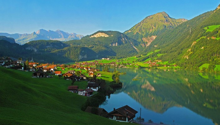 Fantastic village on an alpine lake wallpaper