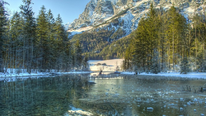 Clear icy lake in a bavarian forest wallpaper