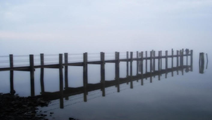 Foggy early morning sea pier wallpaper