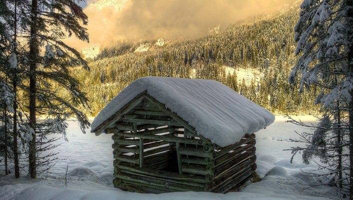 Log cabin in the mountains at winter wallpaper